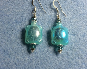 Irridescent turquoise Czech glass turtle bead earrings adorned with turquoise crystal beads.