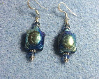 Metallic blue black Czech glass turtle bead earrings adorned with blue crystal beads.