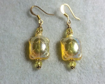 Irridescent yellow Czech glass turtle bead earrings adorned with yellow Crystal beads.