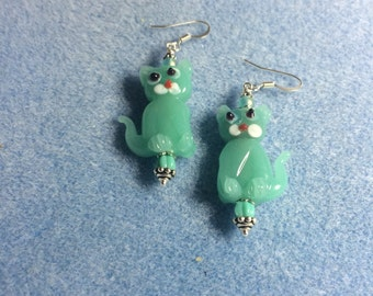 Opaque turquoise lampwork cat bead earrings adorned with turquoise Czech glass beads.