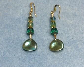 Irridescent blue green rose petal dangle earrings adorned with blue green Czech glass beads.