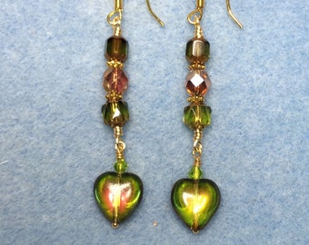 Olive green and burnt orange Czech glass heart dangle earrings adorned with olive green and orange Czech glass beads.