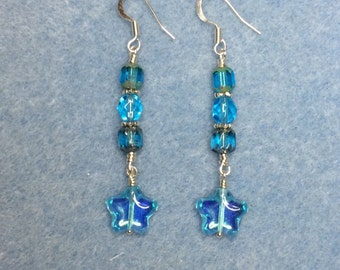 Light turquoise Czech glass star bead dangle earrings adorned with light turquoise Czech glass beads.