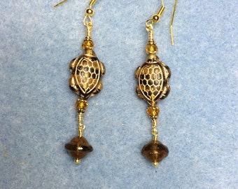 Brown and topaz Czech glass turtle dangle earrings adorned with brown Saturn beads and topaz Chinese crystal beads.