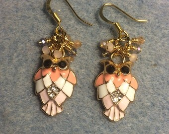 Peach and pink enamel and rhinestone owl charm dangle earrings adorned with tiny dangling peach, pink, and clear Chinese crystal beads.