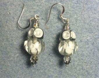 Grey lampwork owl bead dangle earrings adorned with grey Czech glass beads.