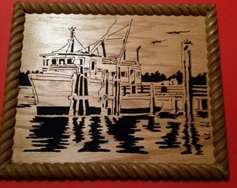 Scroll saw framed picture of a fishing boat