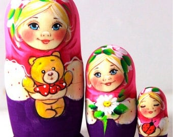 Nesting doll matryoshka Russian girl with a bear and chamomile purple pink - kod49k