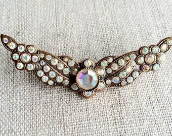 Pretty Vintage Aurora Borealis Rhinestone Brooch set in Copper.  Angel Wings.  Various sizes of aurora borealis stones