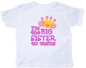 I'm the big sister to twins. Toddler T-Shirt by Inktastic