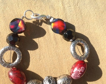Beaded bracelet- Classy glass and metal, reds, black, silver