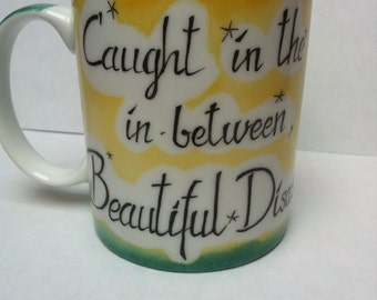 Caught in the in-between, a beautiful disaster.  Personalise your mug!