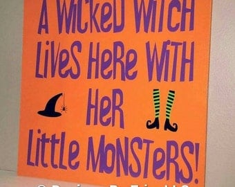 A Wicked Witch Lives Here! Wooden Sign