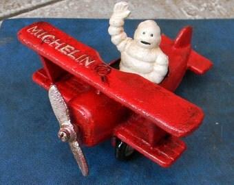 "Superb Hand painted Cast Iron "" MICHELIN MAN Bibendum in Red Aeroplane Biplane"