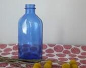 Vintage Phillips Blue Glass Bottle