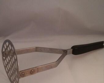 Potato masher, vintage metal kitchen utensil, cooking utensil, kitchen gadget, metal potato masher, vintage utensil
