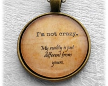 """Alice in Wonderland """"I'm not crazy. My reality is just different than yours."""" Pendant and Necklace"""