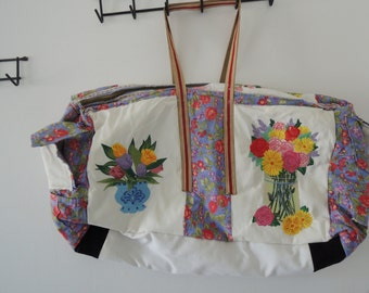 Carry on embroidered tote bag with multiple pockets