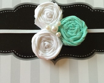 Mint and white rosette elastic headband with white pearls.