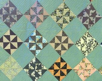 Pinwheels scrap quilt.