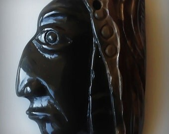 A Wise Soul in Jasper - A drilled Cameo Carving
