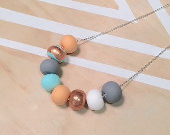 "Polymer clay bead necklace. Mint, peach, copper, grey and white ""THE MINTY"""