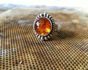 Amber set in silver ring