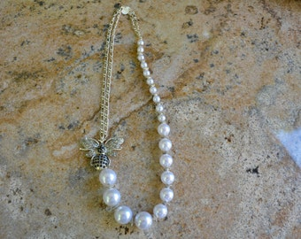 """White Graduated Pearl and Silver Chain 28"""" Necklace with Silver Rhinestone Bee"""
