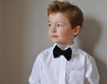 Boys bowtie in black velvet with deep red neck strap by Fred's Finery's 'Mr Darcy'