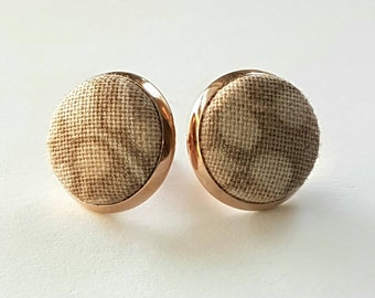 Fabric covered button in rose gold earring setting.