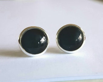 Black glass cabochon stud earrings.