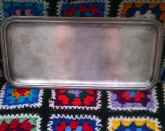 former silver metal tray