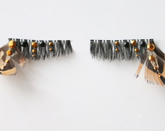 Feather False Eyelashes Embellished with Gold and Black Studs. Trial style, perfect for festival or costume makeup.