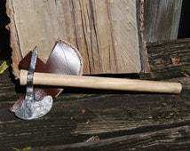 Hand forged Tomahawk, Made from railroad spike, Spalted Sweet Gum handle.  Hand sewn sheath.