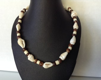 Shell necklace with brown beads made from seeds (item #245)