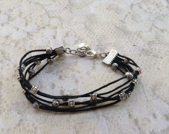 Black with silver beads cord bracelet (item #277)