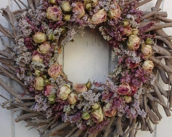 grey twig wreath decorated with dried flowers