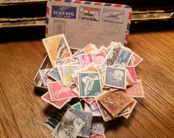Vintage Postage Stamps in a Retro Tin Box
