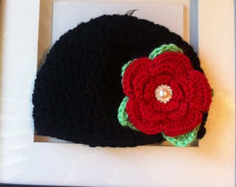 Crochet beanie in black with red flower