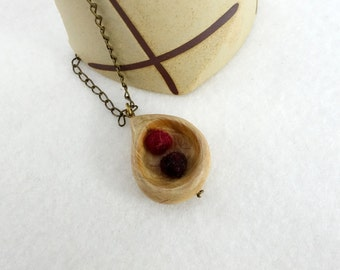 Wooden pendant, juniper wood carved drop and red felted wool balls
