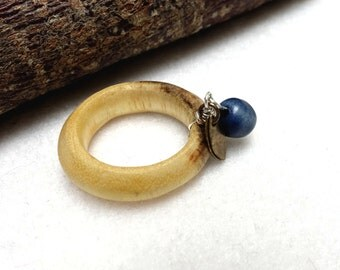 Wooden ring with metallic charm and recycled blue pearl