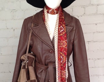 Vintage 1970's genuine leather brown belted jacket