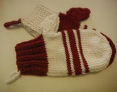 Large mitten Christmas decorations. Knitted red and white stocking mittens matching extra large mittens Holiday