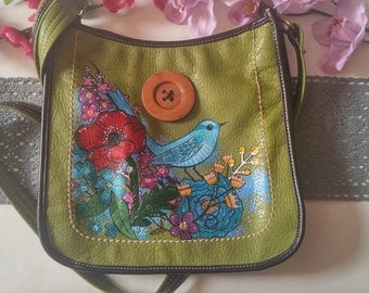Bright and funky upcycled green bag-hand painted with flowers and quirky bird.