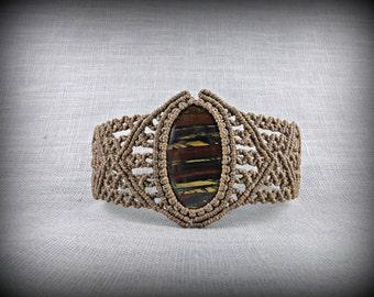 Macrame cuff bracelet with an iron eye cabochon