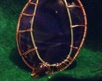 Enchanting wire wrapped stone pendant!