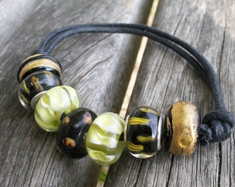 Ethno folk, glass and bracelet, black gold green, vegan, nostalgic, old acting, boho