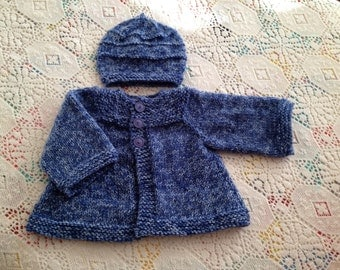 This is a soft, warm, hand knit baby sweater and hat set. It will keep a special baby comfy this winter!