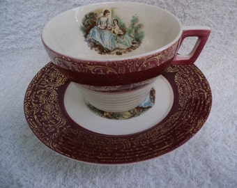 Maroon Cup and Saucer Laced with Gold Trim with Victorian Girls and Minstrel