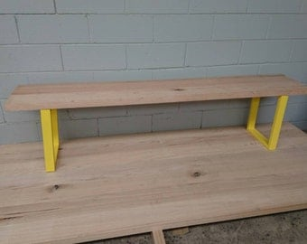 Timber bench seat on steel legs